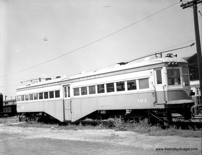 "According to Don's Rail Photos, IT 104 ""was built by American Car in 1917 as AG&StL 64. In 1926 it became StL&ARy 64 and in 1930 it became IT 104."" This picture was taken in Granite City on August 14, 1956."
