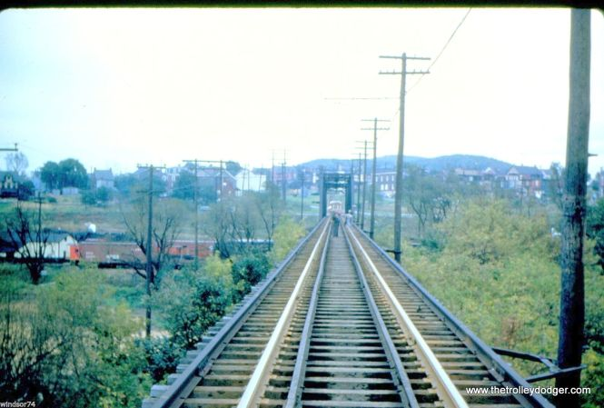 The Lehigh Valley Transit Co. Aineyville Viaduct over the Reading Railroad East Penn Junction in Allentown, PA in 1951.