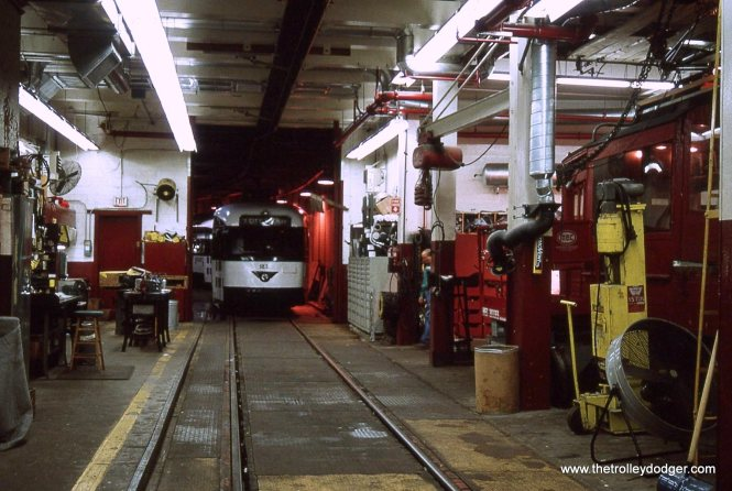 A wide view of car 21 and the surrounding shop area.