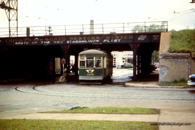"CTA 6172 passes under the Chicago & North Western overpass near the west end of route 16 - Lake in June 1952. We are facing south, and the streetcar would also have just crossed the Lake Street ""L"" tracks on the other side of the viaduct. The ground-level portion of Lake was elevated onto the embankment in 1962. Route 16 ended a short distance west of here at Austin Boulevard, the city limits."