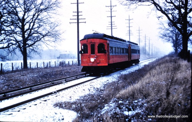 319-320 near the Clintonville Station on the Elgin branch, December 7, 1958. (Mark Llanuza Collection)