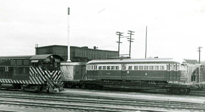 """Here is a postwar Chicago PCC streetcar in the Streator Yard of the Santa Fe, on its way to St. Louis Car Company as part of the CTA's """"conversion program."""" (Phil Becker Photo)"""