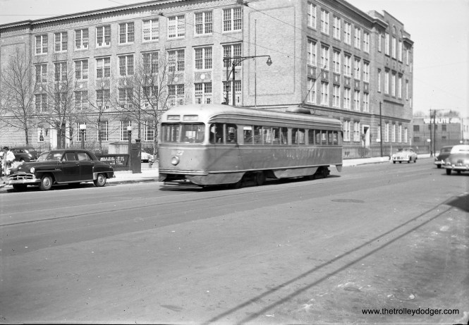 B&QT 1027 on April 18, 1954, with one of New York's many public schools in the background.