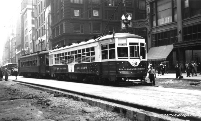 CSL's War Bond car during World War II. This picture was probably taken around 1942 on State Street while the streetcar tracks were being redone as part of the subway construction project.