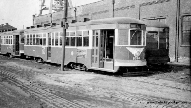 """CTA Sedan (aka """"Peter Witt"""") 6310 appears to have been converted to one-man in this view circa 1952 view at South Shops. However, it may not have been used in service this way before being scrapped. (Roy W. Bruce Photo)"""