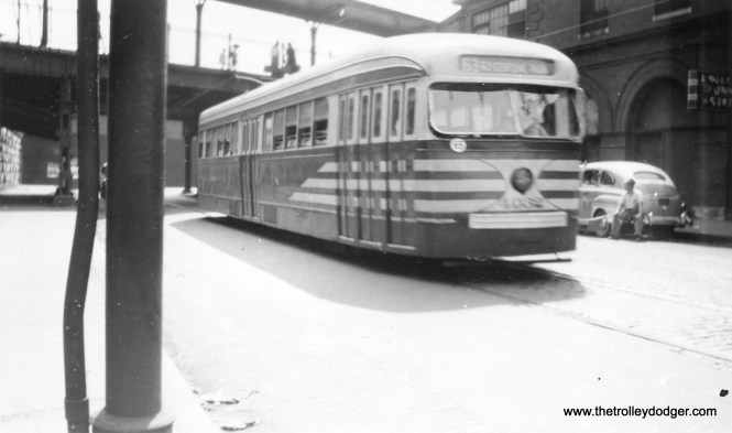 """This picture is a bit blurred due to motion, but it does show prewar CTA PCC in July 1948, heading west at Englewood Union Station, at that time an important train hub. M. E. writes: """"Actually, the westbound streetcar is in the process of passing the Englewood Union Station, which is the building on the right. Behind the streetcar is the platform for New York Central and Nickel Plate trains. Behind the photographer is the platform for Rock Island trains. To the right of the station is the platform for Pennsylvania Railroad trains."""""""