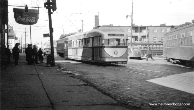 This picture of 7001 at Clark and Schreiber, with Devon Station at left, was taken just a few seconds after one you will find here. The pre-PCC car is in the same position in both shots but the automobile at left has pulled up in the other photo. That version gives the photo credit to R. J. Anderson, while this one gives the date-- February 29, 1940. The car's colors are listed as their original silver and green.