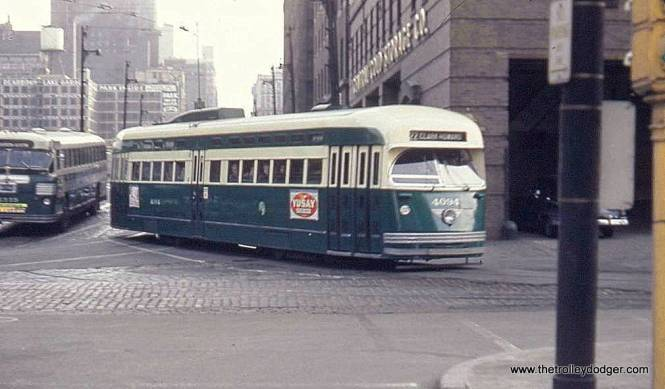 """CTA PCC 4094 near downtown. George Foelschow: """"Car 4094 is making the turn from northbound Dearborn Street into Kinzie Street. When Clark and Dearborn were made one-way, northbound cars on Dearborn used the former southbound track. I have heard that after both Broadway and Clark were abandoned and only Wentworth remained, CTA briefly considered turning cars on Randolph Street, but the two river crossings persisted until the end."""""""