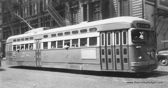 """It's hard to make out the location of this Pullman-built postwar PCC. One of our readers writes: """"I believe that this photo was taken on Dearborn Street just north of Adams. The building in the background on the far left looks like the Marquette Building. The front destination sign reads 42 and the side sign reads Halsted-Archer-Clark."""""""