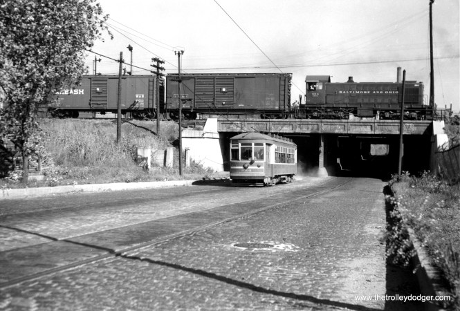"""CSL 3303 on the 59-61st Street route. Andre Kristopans: """"3303 on 59/61 is just east of Western. These days CSX's big intermodal terminal is overhead where the S2 is."""" (Joe L. Diaz Photo) 3303 was part of a series known as Multiple Unit cars. According to Don's Rail Photos, """"These cars were built by CSL and have the same body style as the 1923 12-window cars, but were built with maximum traction trucks. A number were converted to one man operation as indicated by the white stripe on the ends. 3203 was built by CSL in 1924. It was rebuilt (for) one man service in 1932."""""""