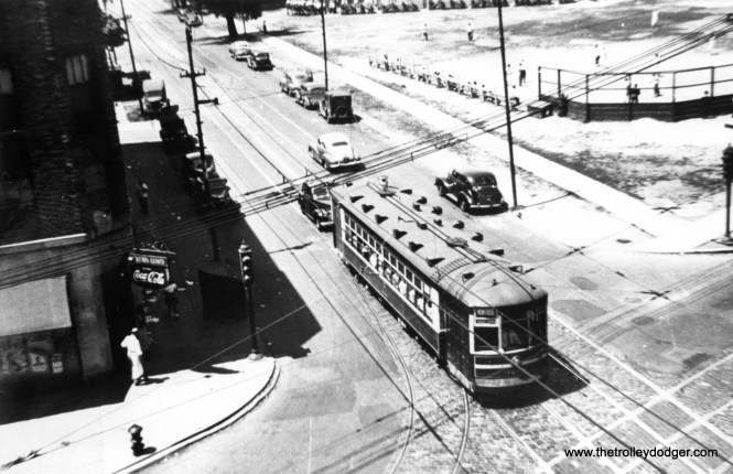 """CSL 32XX in a rather contrasty picture. Andre Kristopans: """"The 3200 with unknown exact number is EB on Montrose at Lincoln. Welles Park in background."""""""