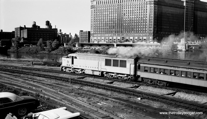 The late Bob Selle took this great shot of an outbound Milwaukee Road commuter train leaving Union Station in Chicago on August 8, 1958. These were some of the consists I saw as a child, since I lived very close to what is now the Metra Milwaukee District West Line. Ridership was nothing compared to what it is today, and I believe bi-levels were not introduced here until around 1961-62. That's the Merchandise Mart across the Chicago River. This picture was taken from the Lake Street overpass. That looks like a 1957 Oldsmobile convertible at left.