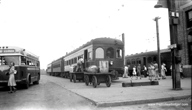 Busy action at an Illinois Terminal station, but where? Perhaps the bus sign might be a clue. This type of scene was once commonplace in American life during the first half of the 20th century. PS- Don Ross says this is Springfield.