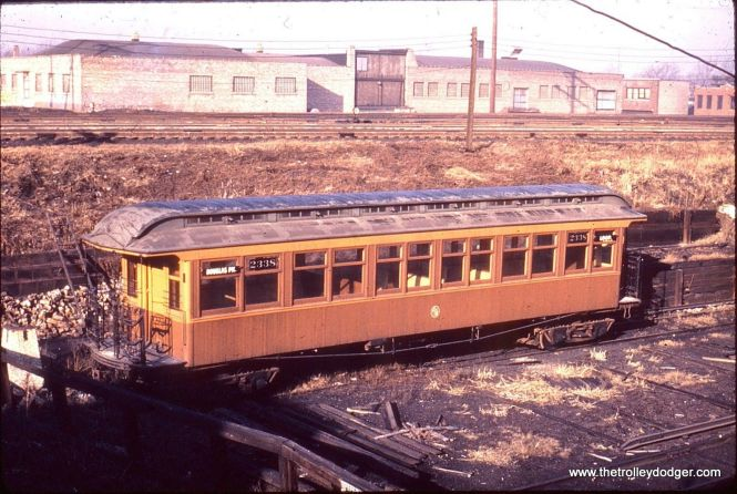"That this is a CTA wooden ""L"" car (#2338) signed for the Douglas Park line is clear, but not the location. Where could this picture have been taken?"