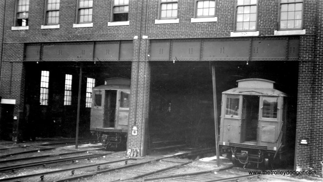 "These are Chicago Metropolitan ""L"" cars, but where was this picture taken? There seems to be dirt beneath the tracks, indicating we are at ground level."