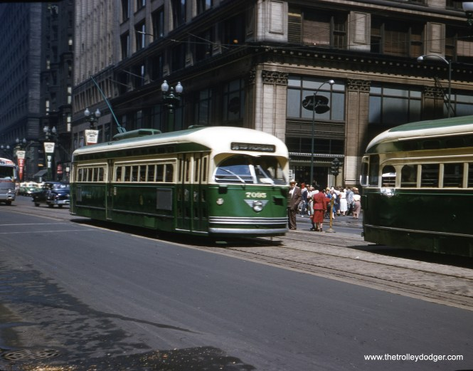 CTA 7095 heads south on State Street on route 36 Broadway-State on August 18, 1954. You can see the Mandel Brothers department store in the background. We discussed this retailer in our previous post Lifting the Lid in the Loop (April 12, 2016), which makes Madison the cross street. Mandel Brothers was bought out by Wieboldt's in 1960, and their store occupied this site into the 1980s. This image was taken on size 828 film, which was meant to be Kodak's answer to 35mm starting in the late 1930s. It offered 8 pictures on a roll, with an image area nearly 30% bigger than 35mm, and had notches in the film so that cameras could use an automatic frame counter/spacer, potentially eliminating the troublesome little red window on the back of the camera. Although Kodak promoted this format in the stylish Art Deco Bantam series of cameras, it did not catch on and 828 film was discontinued by Kodak in 1985. However, the technology behind 828 was later used in the very much more successful 126 cartridge format starting in 1963. It is actually still possible to get 828 film today that has been respooled and cut to size from larger formats.