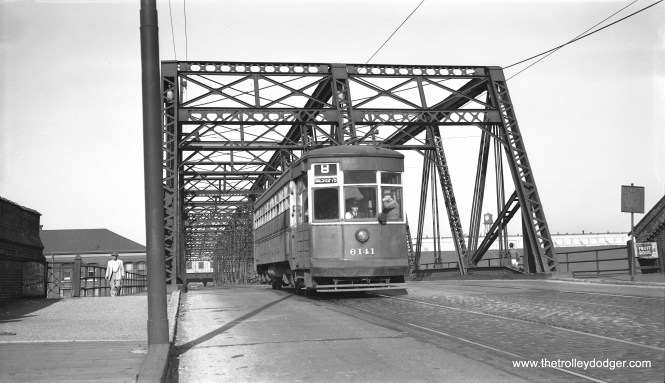 """CTA two-man arch roof 6141 coing off the south end of the Halsted Street bridge over the Milwaukee Road on November 16, 1953. This car was known as one of the """"Odd 17"""" (actually 19), probably because it did not fit into some other series. Don's Rail Photos says, """"6141 was built by American Car Co in February 1918, #1079."""" (Bob Selle Photo)"""