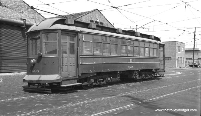"""CTA salt spreader AA98 was former """"Interstate"""" car 2846, shown here being operated for probably the last time ever on May 25, 1958 at CTA's South Shops. The occasion was a CERA fantrip on the last remaining Chicago streetcar line, so everything old that could run was trotted out for pictures. This car was soon purchased by the Electric Railway Historical Society, and eventually made its way to the Illinois Railway Museum, where it is preserved. (Bob Selle Photo)"""