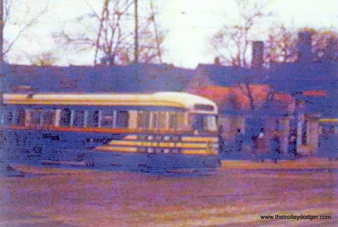 """Tiger stripes"" on route 20 - Madison, leaving the Madison-Austin terminal. (John Marton Collection)"