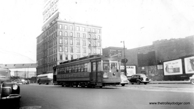 CSL/CTA Pullman 441 on Roosevelt Road, west of the Illinois Central station, circa the 1940s. Not sure what the bus is at rear.