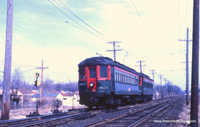 NSL 705 and 709 are near the Mundelein terminal on March 25, 1962.
