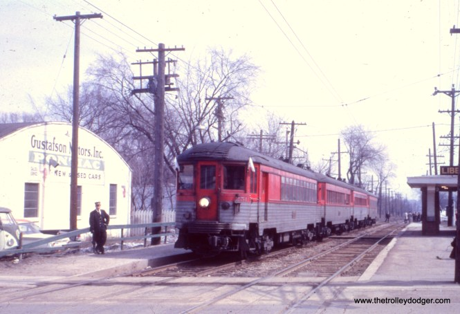 "I don't know just when this picture of a North Shore Line ""special"" train was taken, but Gustafson Motors was located in Libertyville, along the Mundelein branch. FYI, we have several North Shore Line audio recordings available on compact disc in our Online Store, including some from the Mundelein branch. Garrett Patterson: ""nsl003 would have been taken just weeks before the end of service system-wide. The 1962 Bel Air in the lot dates the photo."" One of our regular readers adds: ""This was the CERA fantrip that was operated in April 1962. George Krambles operated the train in Evanston, and there are movies and slides of the train going south from Isabella going up the hill to the North Shore Channel bridge. The scene is seen in The Tribute to the North Shore Line video, which has been presented at January CERA meetings (although it is not commercially available). Of course the above photo is at Libertyville (which was a beautiful place in the country at one time)."""
