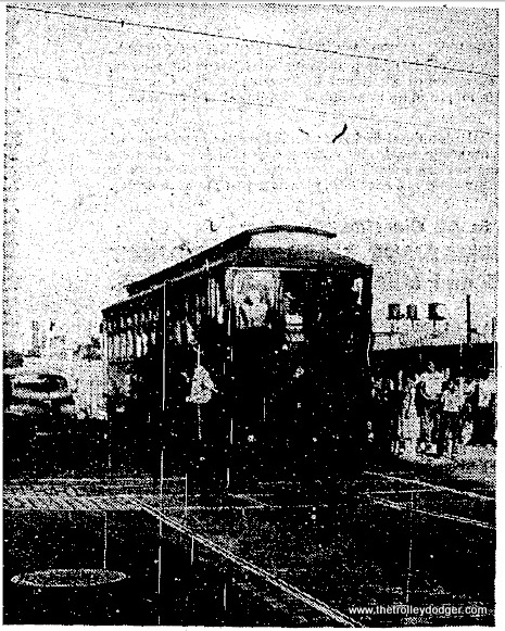 """A wooden """"Met"""" car was one of the first test trains on the CTA's Van Buren temporary trackage. The date is August 18, 1953. Testing continued for a month to familiarize pedestrians and motorists with the operation."""