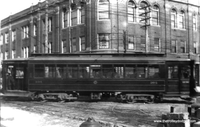 """Motion blur makes it hard to read the car number, but this is a Pullman in the (natch) """"Pullman green"""" color scheme prior to the adoption of red in the 1920s. One of our regular readers writes, """"Chicago Railways Pullman No. 191. Note the Chicago Railways logo on the side of the car. The CRys logo was very similar to the CSL logo. This photo was probably taken between 1908 and 1914 when CSL started operations. The cars were not painted red and cream until the early 1920s when CSL adopted that color scheme."""" (Fred J. Borchert Photo, Edward Frank, Jr. Collection)"""