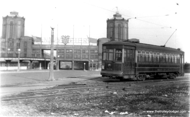 """The number on this car at Navy Pier looks like 3010, which would make it a Brill. Andre Kristopans: """"3010 at Navy Pier is probably working Stony Island-Wabash. This was the """"short loop"""" roughly in the middle of Navy Pier Park, surrounded by Streeter Drive. Grand cars turned back next to the ramp on the left, which had once had streetcar track going to the upper level of the pier, but by this point was for truck access. The short loop was paved for trolley bus use in 1951, and by 1955 or so replaced by a new TT loop which was accessed from Streeter & Illinois, which lasted until the complete rebuilding of the area in the 1990's."""" (Edward Frank, Jr. Photo)"""