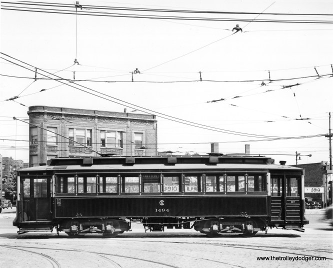 "An early photo of CSL 1494 in charter service. This was called a ""Bowling Alley"" car due to the sideways seating. Don's Rail Photos: ""1494 was built by CUTCo in 1900 as CUT 4543. It was rebuilt as 1494 n 1911 and became CSL 1494 in 1914. It was rebuilt as salt car and renumbered AA83 on April 15, 1948. It was retired on October 7, 1954."""
