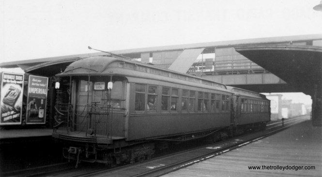 "Here is the Lake Street view of Lake Transfer, with two woods in the station. Riders could change here for the Met ""L"" Logan Square and Humboldt Park trains. (George Trapp Collection)"