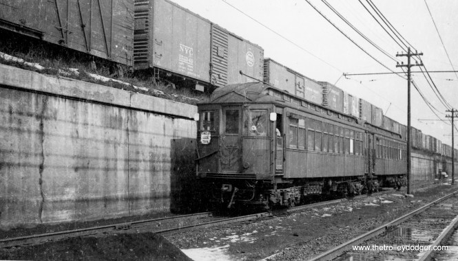 """This is a Lake Street local train, heading west on the ground level section, which was elevated in 1962. Since this photo predates A/B """"skip stop"""" service, it must date to before April 5, 1948. (George Trapp Collection)"""