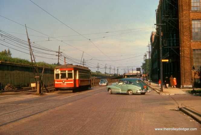"CTA 1745 is westbound at Lake and Long in June 1952 on route 16. Here, it ran parallel to the ground-level portion of the Lake Street ""L"", also under wire."