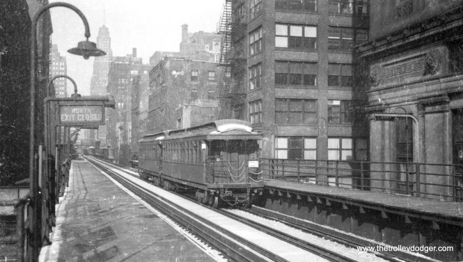 "This photo of two gate cars on the Loop ""L"" is a bit scratchy, but I think I recognize the Insurance Exchange Building at right, which would make this the Wells leg of the Loop, looking north. (George Trapp Collection)"