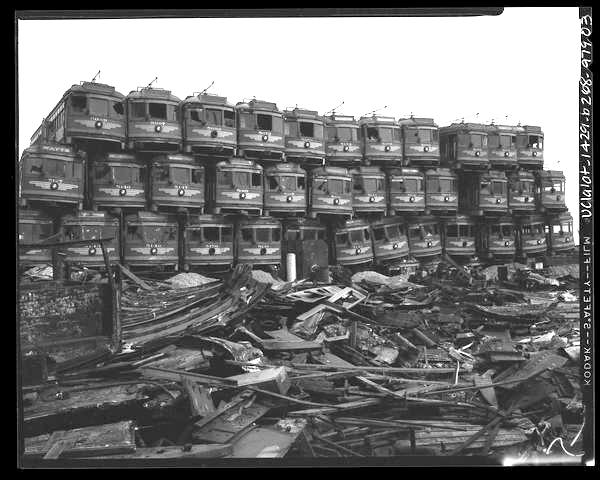 AWAITING DESTRUCTION--Old Pacific Electric cars are piled up like toys at junkyard on Terminal Island, awaiting dismantling to become scrap metal. (Los Angeles Times Photographic Collection)