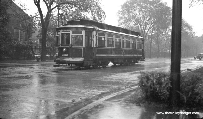 "CSL 2601 is shown running on the last day of streetcar service on route 111 (111th Street), September 22, 1945. As for the exact location, Andre Kristopans says this is ""probably just west of Indiana Av., looks like the school campus in background that is between King and Indiana to this day."""