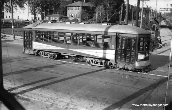 """Don's Rail Photos says Chicago & West Towns car 106 """"was built by McGuire-Cummings in 1915. It was dismantled in 1943."""" Here, we see it heading north on Harlem and Stanley in 1936, having just crossed the Burlington RR."""