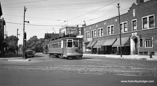 CSL 5324 is a southbound Ashland car on Southport at Lincoln on August 17, 1947. The building at right was a funeral home.