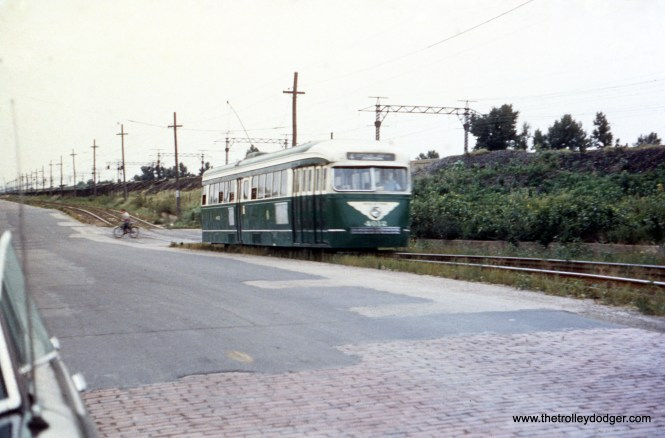 "Prewar PCC 4012 on Cottage Grove in 1952. Jack Fuller adds, ""The Green Hornet view along Route 4, Cottage Grove is actually at 99th Street. This is the only opening under the Illinois Central tracks between 95th Street and 103rd Street."" (C. R. Scholes Photo)"