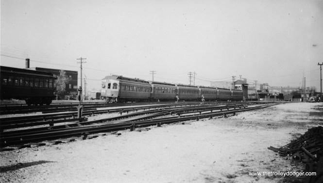A 6-car train of CA&E woods near Laramie Avenue on May 7, 1937.