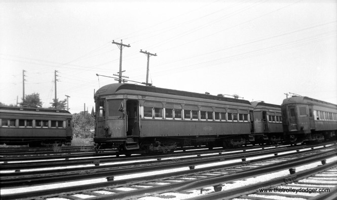 """CA&E wood car 138 at the Wheaton Yard on July 3, 1949. Don's Rail Photos says, """"138 was built by American Car Co in March 1910, #844, as C&ME 138. It was rebuilt in 1914 and no retired date."""" This was one of several cars leased from the North Shore Line in 1936 and purchased from them a decade later. Ironically, this made them the last passenger cars bought by CA&E. They were considered surplus after service was cut back to Forest Park in 1953 and were scrapped shortly thereafter."""