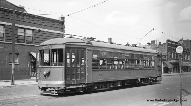 C&WT 146 at Lake and Austin, east end of the line. Riders could change across the street for a Chicago car. The Park Theater, at right, was showing Sutter's Gold, starring Edward Arnold. That film was released in 1936, which may be the date of this photo. This car was built by McGuire-Cummings in 1924.