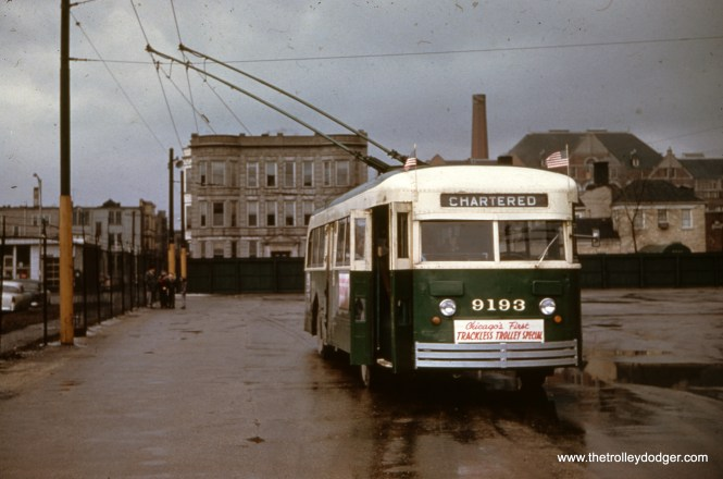 "CTA trolley bus 9193 on a March 2, 1958 Omnibus Society of America fantrip, at Kedzie Garage. Andre Kristopans: ""This is in BACK of Kedzie, facing south. The wire came in off Kedzie between the carhouse and the washhouse, looped around in back and split into the three wired bays."""
