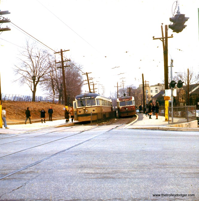"SEPTA Brilliners 9 and 3 meet in February 1971. Kenneth Achtert: ""Brilliners 9 and 3 are at Lansdowne Ave. (#9 outbound). The teenagers are students from Monsignor Bonner HS (boys) and Archbishop Prendergast HS (girls), out of view to the left. The schools have since been combined."""