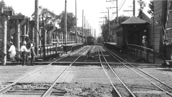"""We originally ran another version of this photo in our post Chicago Rapid Transit Photos, Part Five (Spetember 26, 2016), where it was identified as Noyes Street in Evanston looking south. This version of the photo has less cropping and is dated August 10, 1928. Work is underway on elevating this portion of the Evanston """"L""""."""