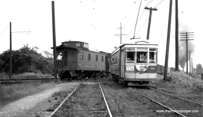 "Here, C&WT 119 appears to be crossing the Illinois Central at 26th Street, since that is an IC caboose at the rear of the passing freight train. Don's Rail Photos: ""119 was built by McGuire-Cummings in 1912. It was scrapped in 1948."" (Joe L. Diaz Photo)"
