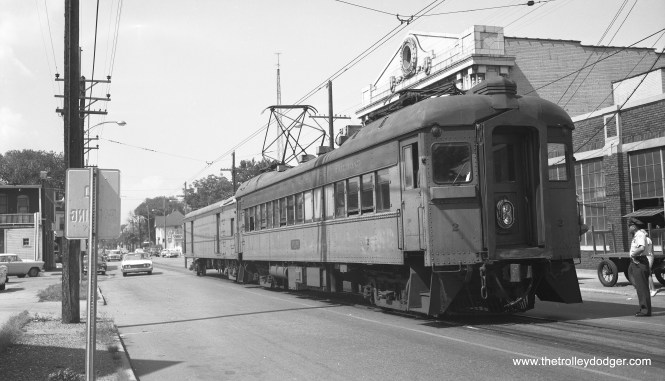 "CSS&SB cars 2 and 504 at the Michigan City station on August 30, 1960 (note the 1960 Ford at left). Don's Rail Photos: ""2 was built by Pullman in 1926."" Frank Hicks writes: ""This interurban freight trailer has a more unusual history than most. It was built for ISC as an interurban combine, and ran on that system's lines in Indiana for five years until ISC became part of the great Indiana Railroad system. IR rebuilt the three cars of the 375-377 series into railway post office cars and put them to use in this unusual capacity. The three RPO's survived on IR until the end of interurban service in 1941, at which time all three were sold to the only other interurban line then operating in Indiana: the South Shore. The South Shore converted 376 into a line car while 375 and 377 became express package trailers. These cars were designed to run in passenger trains and had control lines so that they could be run mid-train; they were often used to transport newspapers. Car 504 was retired in 1975 and acquired by IRM, which has repainted it and put it on display."" (Photo by Meyer)"