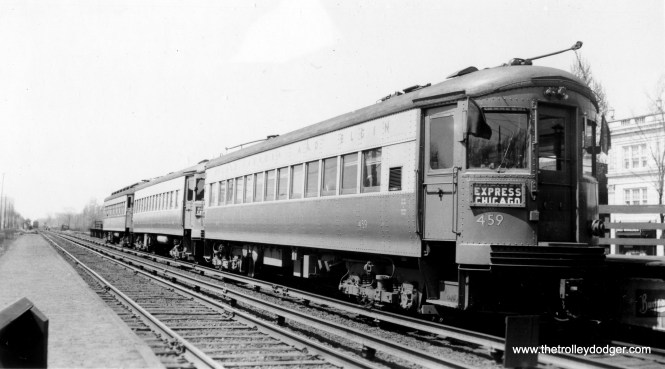 """CA&E 459 is at the tail end of a three-car outbound train at Oak Park Avenue on the Garfield """"L"""". The building at right is still there, now fronting the Eisenhower Expressway."""
