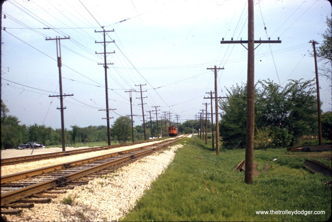 Outbound Chicago, Aurora & Elgin 460 in Aurora on May 19, 1957. Near the terminal, overhead wire was used instead of third rail. Passenger service only lasted another six weeks before abandonment.