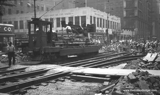 Chicago Surface Lines crane X-3 at Dearborn and Washington in 1942. Tracks were being put back in the street after construction of the Dearborn Subway, which was 80% completed when work stopped due to wartime materials shortages. The subway did not open until 1951.